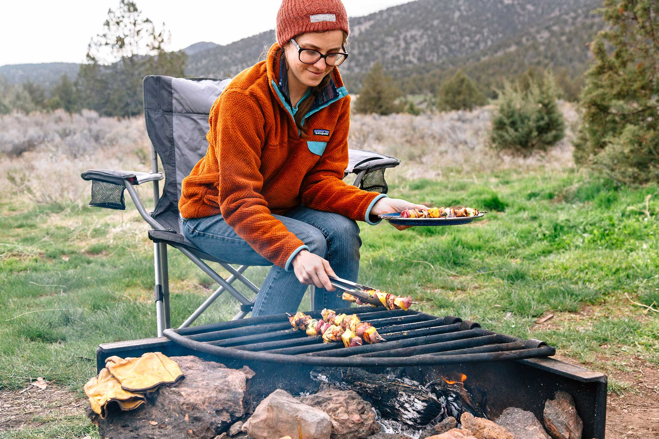 grilling pineapple chicken kebabs while car camping