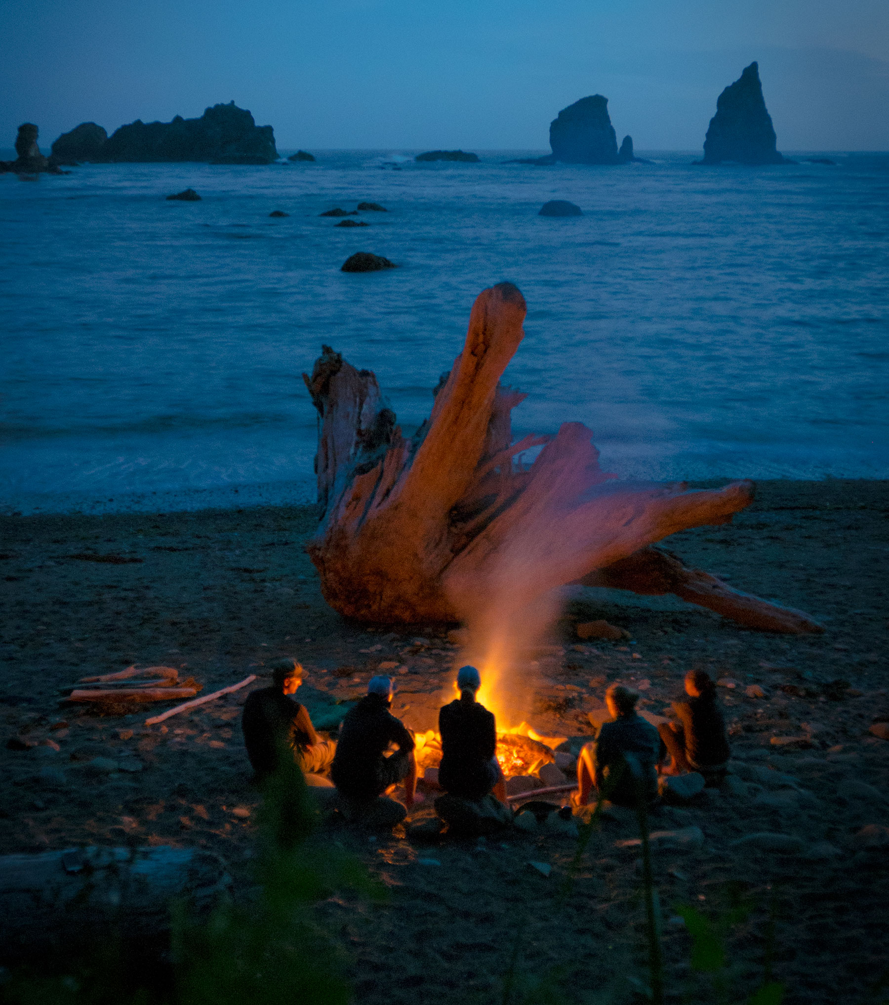 Driftwood campfire in Olympic National Park Wilderness Coast Backpack Trip