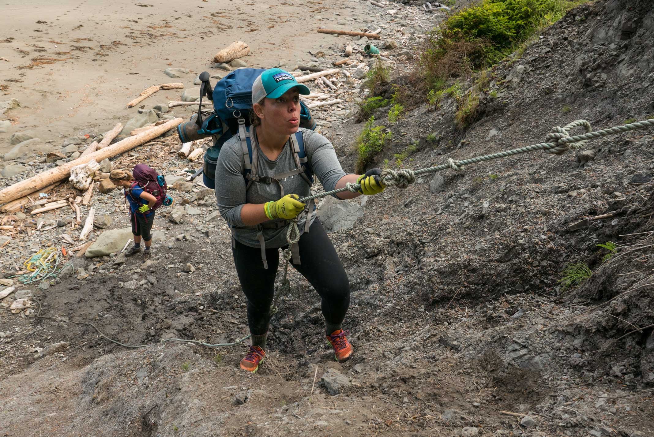 Using ropes to climb a headland on Wilderness Coast, Olympic National Park